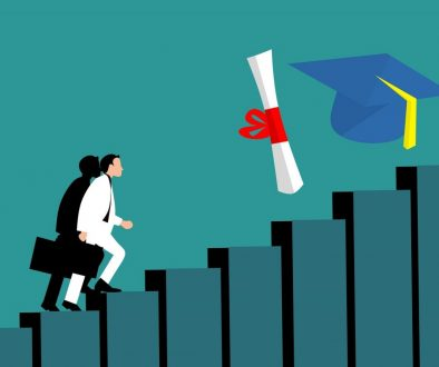 man climbing steps graduation scroll and hat