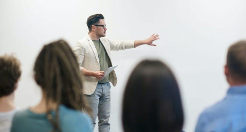 Man Teaching Adults